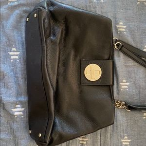 Black Kate Spade handbag with pink inside lining.